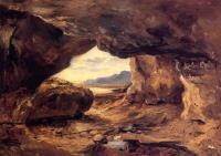 Пещера в скалах вблизи Гранвилля